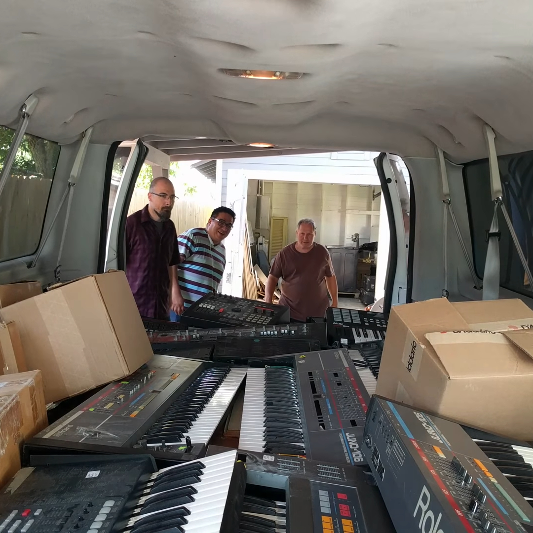 Cliff, Eddie, and Gerald get their first look in the back of a van filled with keyboards.