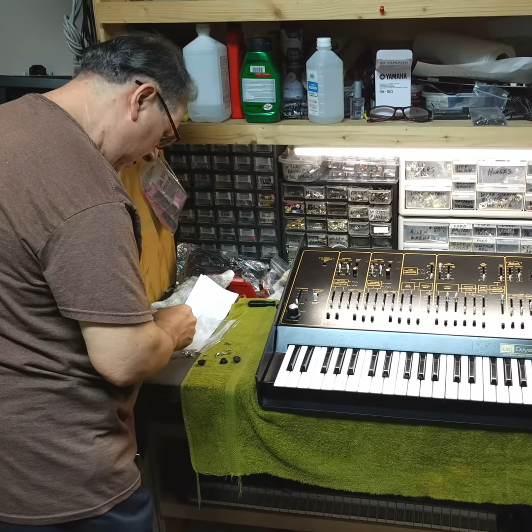 Gerald with an ARP Odyssey on the workbench.